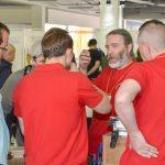 Группа в красных футболках, в центре А.Ю.Дейкин